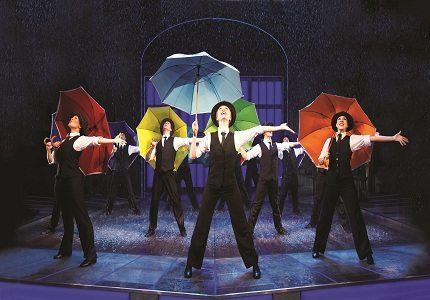 SITR - Production Shot - Cast with Umbrellas 4903x2753