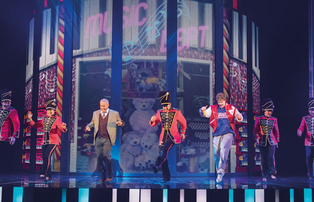 Jay McGuinness dancing on stage in Big the Musical at the Dominion Theatre