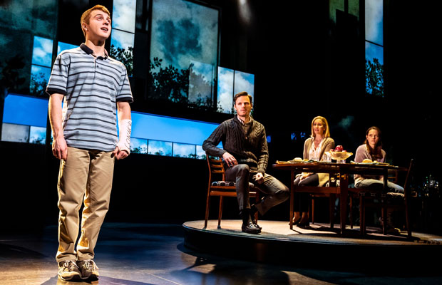 Sam Tutty with other cast members on stage in Dear Evan Hansen