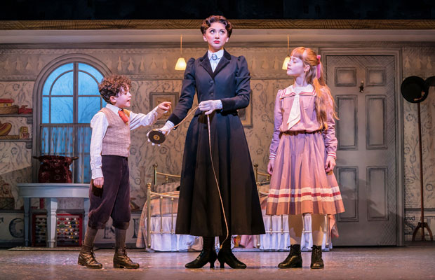 Zizi Strallen with two child actors on stage in Mary Poppins at the Prince Edward Theatre