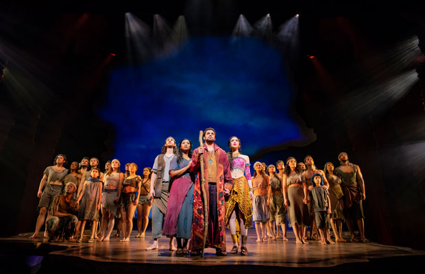 Luke Brady as Moses on stage with the cast of The Prince of Egypt